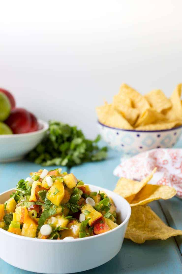 Fresh Peach Salsa with onions and cilantro.