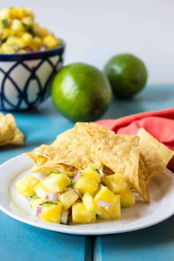 Pineapple Salsa with red onions and cilantro served with corn chips
