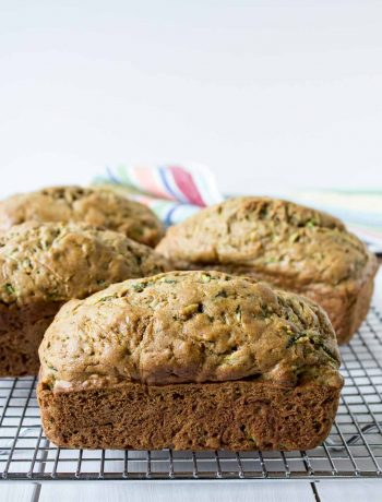 Whole wheat zucchini bread on a baking rack.