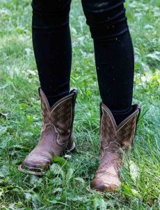 A pair of boots on green grass.