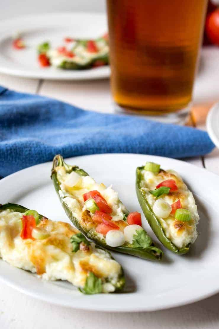 Jalapeno Poppers topped with fresh tomatoes and onions.