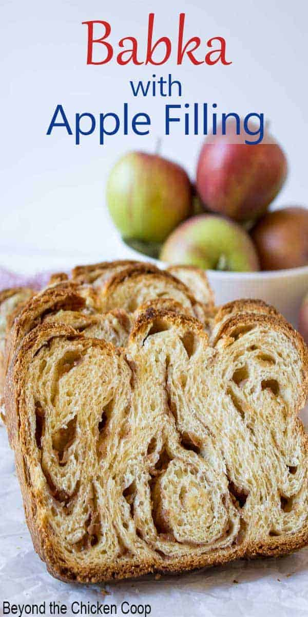 A slice of bread filled with apples and cinnamon.