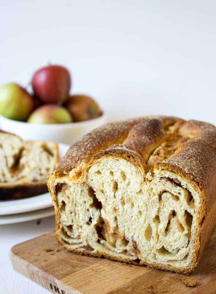 A loaf of apple cinnamon babka sliced to show the impressive interior.