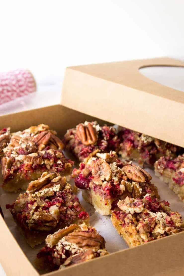 A gift box filled with Cranberry Pecan Bars
