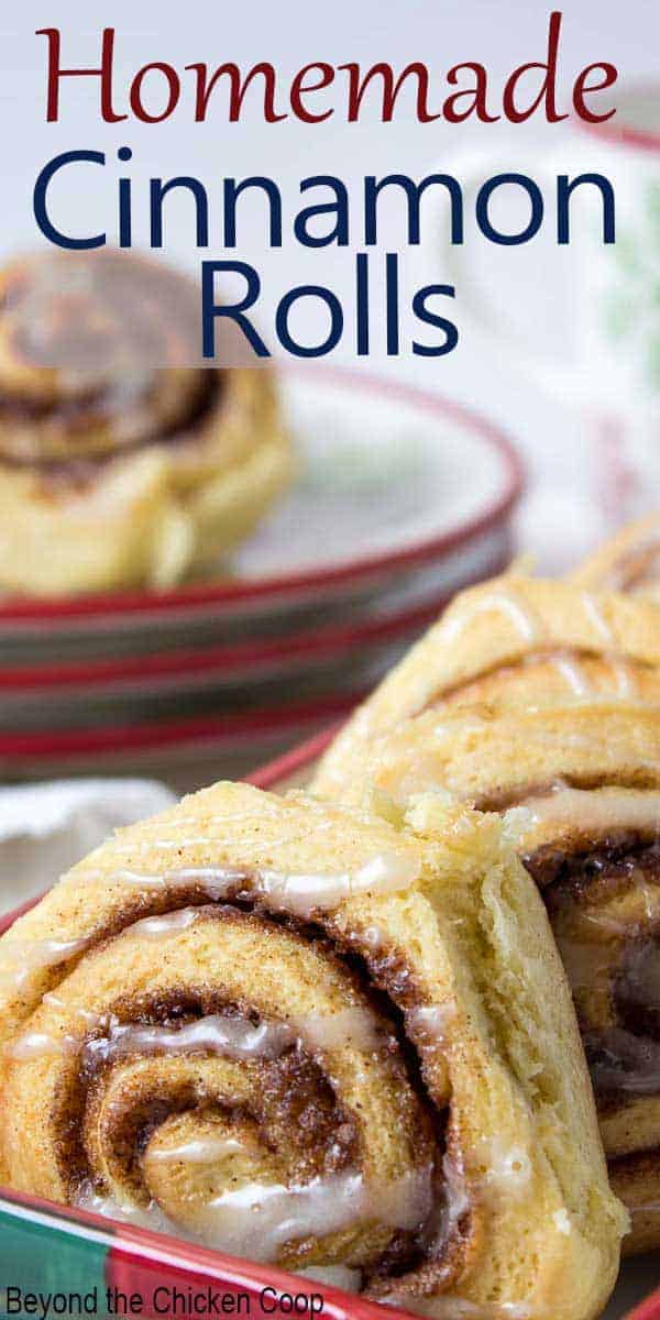 Sweet rolls in a serving dish and on a stack of holiday plates.