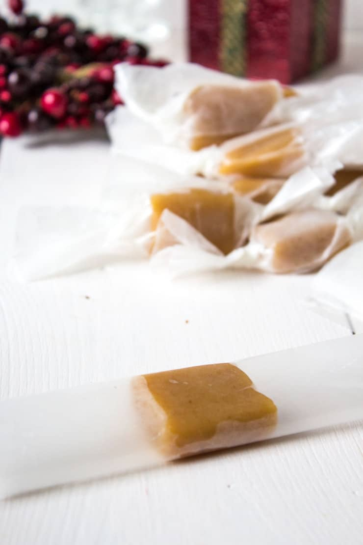 Homemade caramels being individually wrapped.