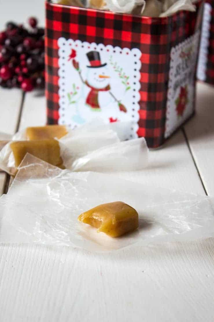 A homemade caramel with a bite out of it.