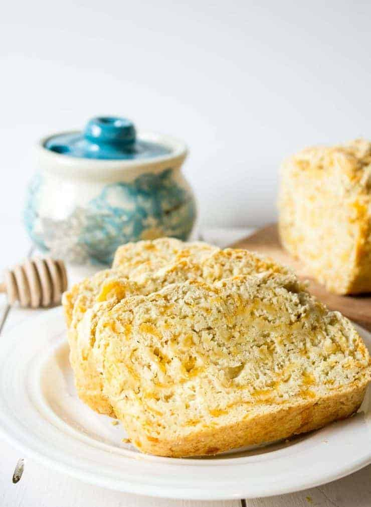 A delicious slice of beer bread with cheddar cheese.