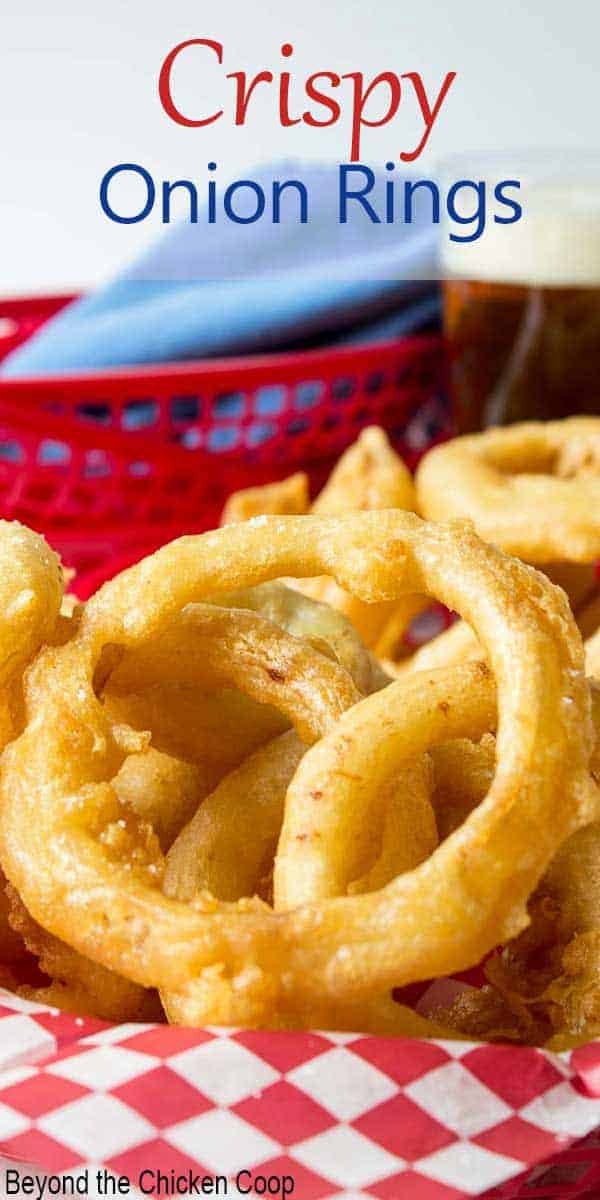 A red basket filled with fried onions.
