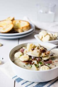 Spoonful of hot clam chowder made with fresh Purple Varnish Clams