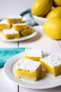 A perfect afternoon snack of a plate of lemon bars.