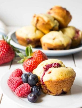 Homemade Triple Berry Muffins are filled with strawberries, raspberries and blueberries.