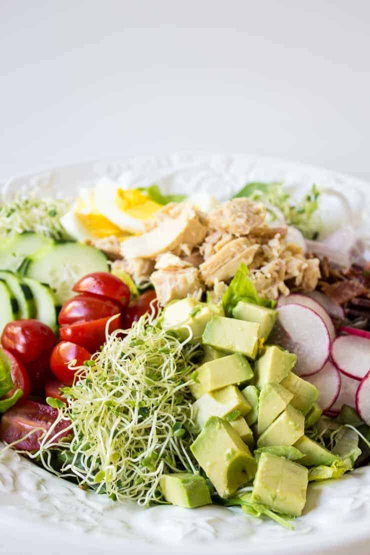 Tuna cobb salad made with fresh veggies, hard boiled eggs, and tuna.