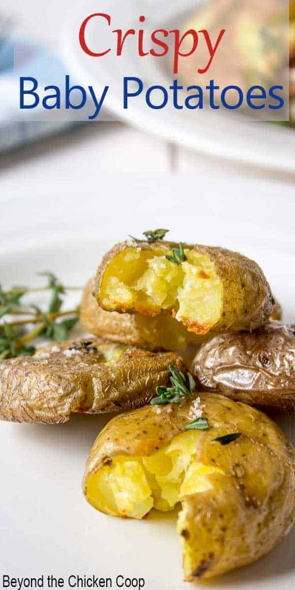Small potatoes with herbs piled on a small white plate.