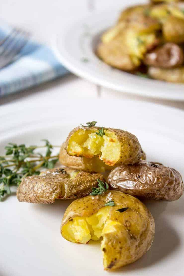 Crispy Smashed Potatoes are creamy on the inside and crispy on the outside. They are a perfect side dish for a casual dinner or an elegant get-together.