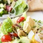 Salad with tuna, tomatoes and cucumbers.