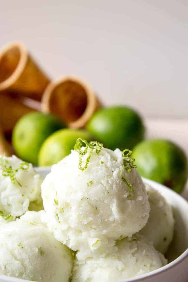 A closeup of lime ice cream topped with fresh lime zest.