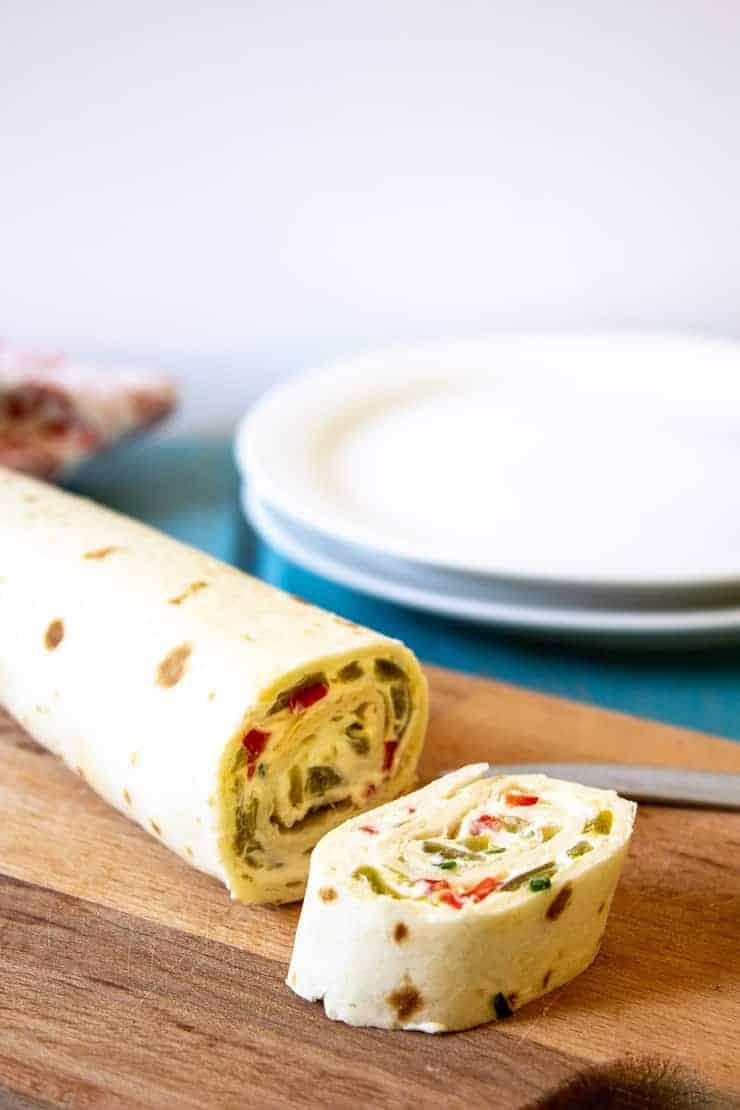 Slicing up a roll of Mexican Tortilla Pinwheels.