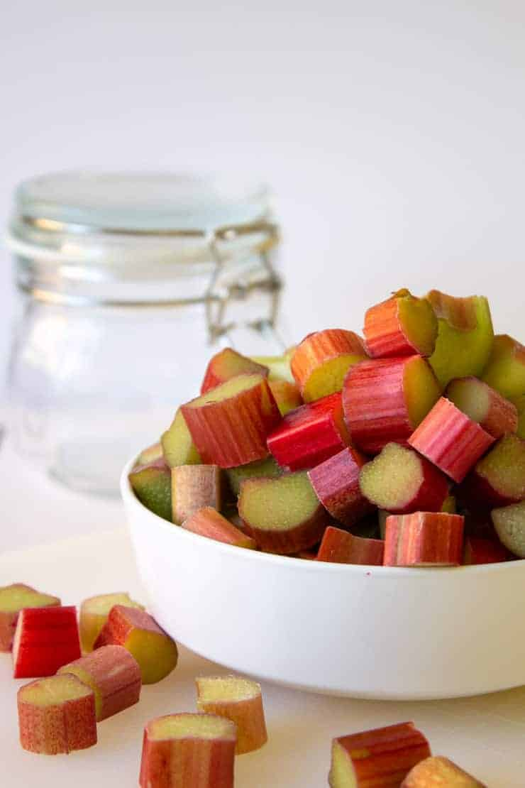 Cut rhubarb for in a white bowl.
