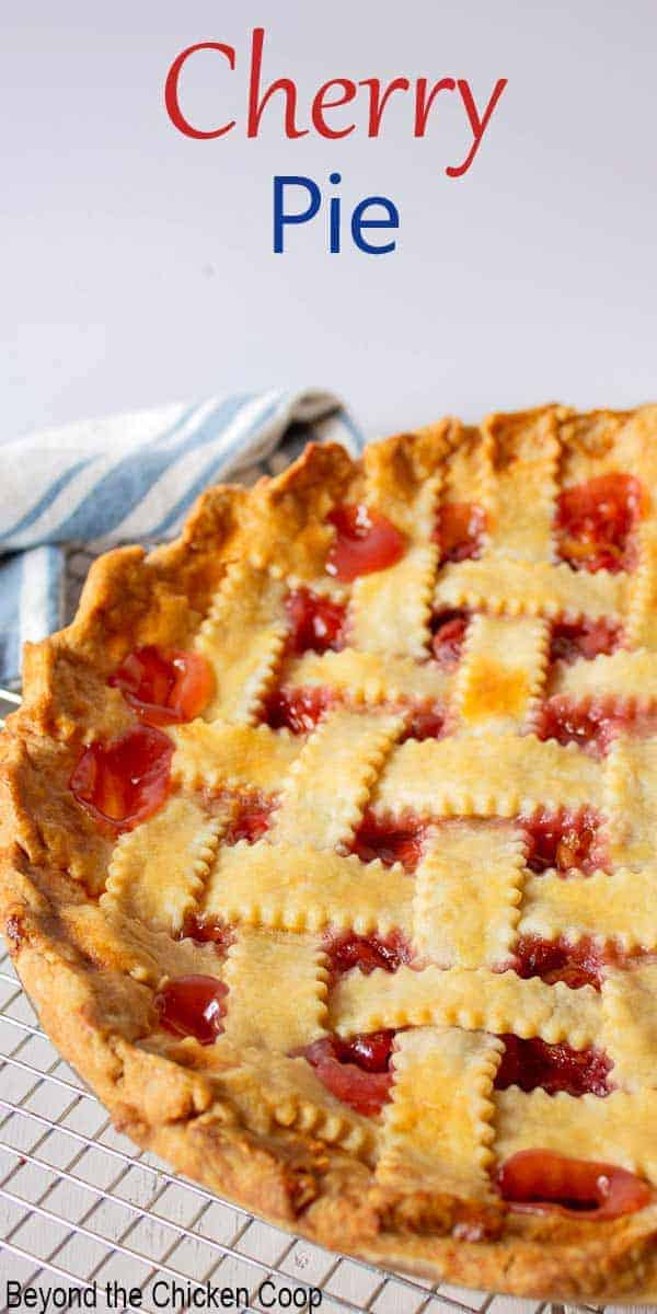 A whole cherry pie with a lattice crust.