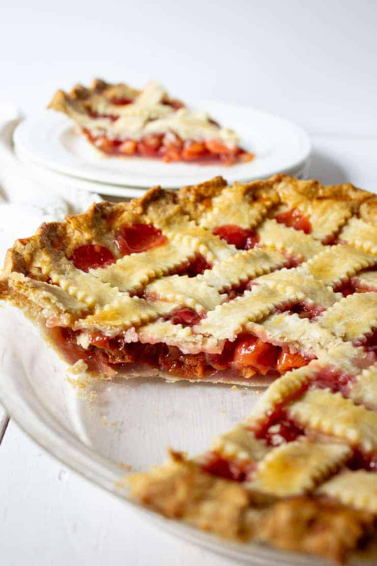 Homemade Cherry Pie with a lattice topping and a slice out of the pie.