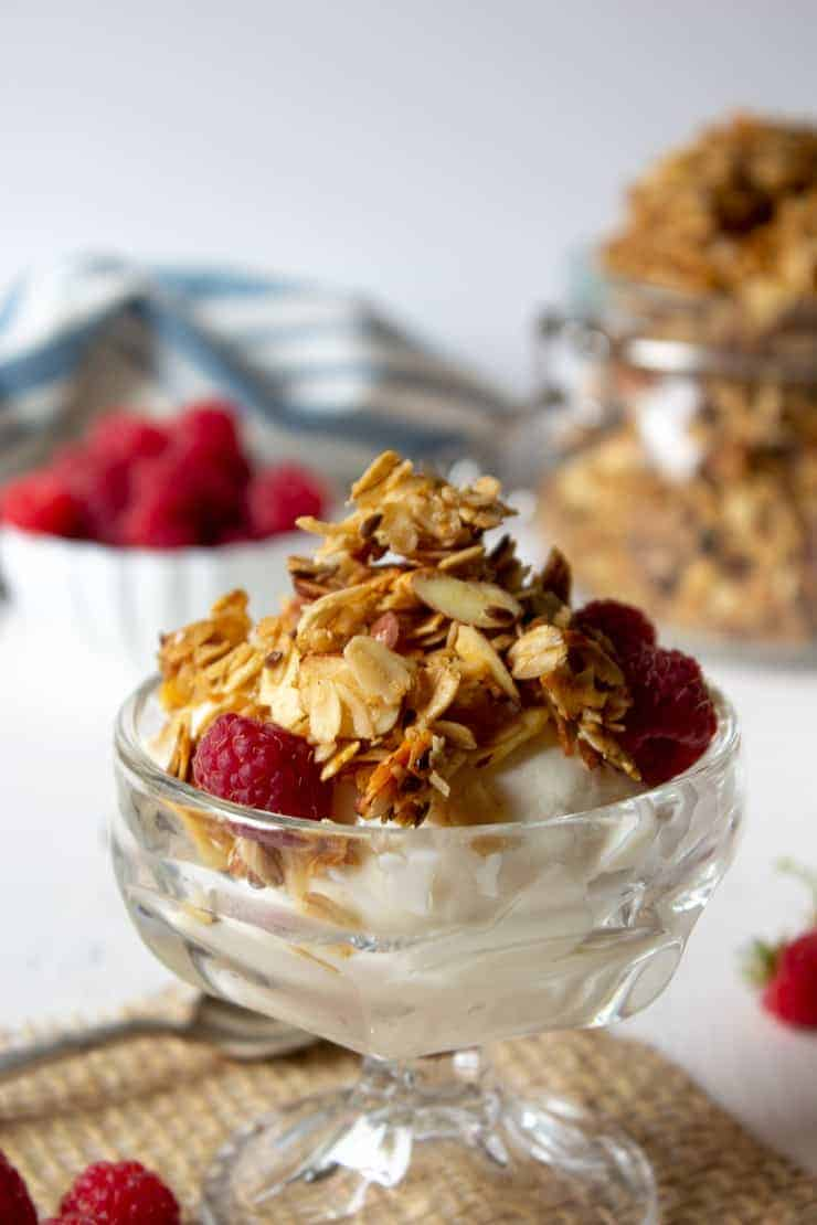 Homemade granola with sliced almonds and flax seed served over yogurt.
