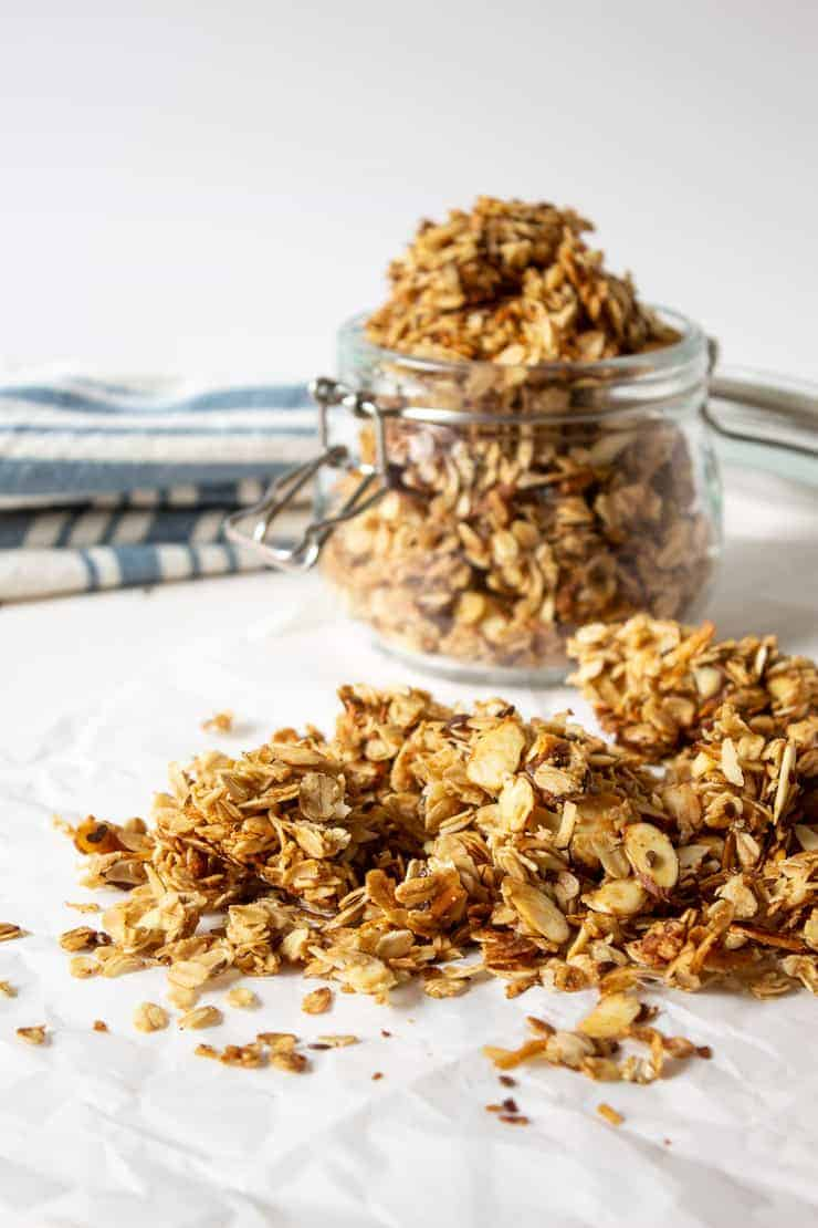 Homemade granola poured on a piece of parchment paper.