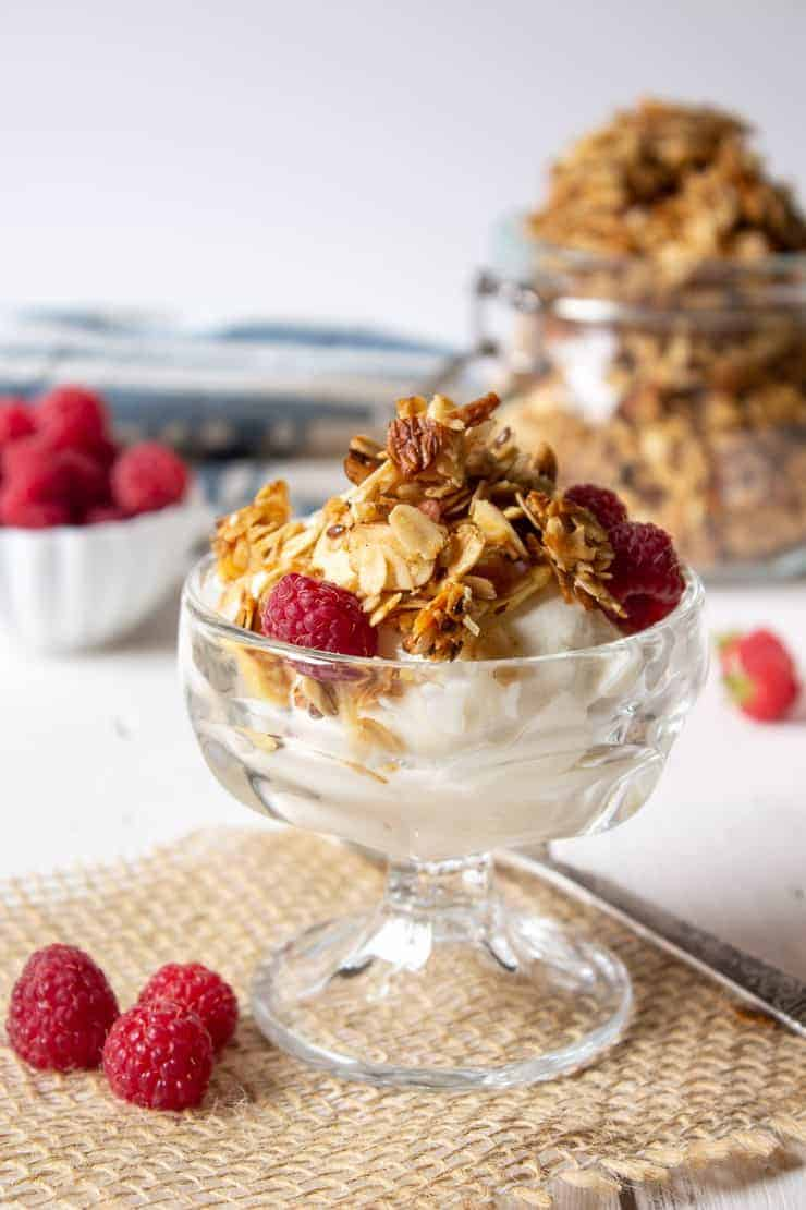Homemade granola parfait with fresh raspberries.
