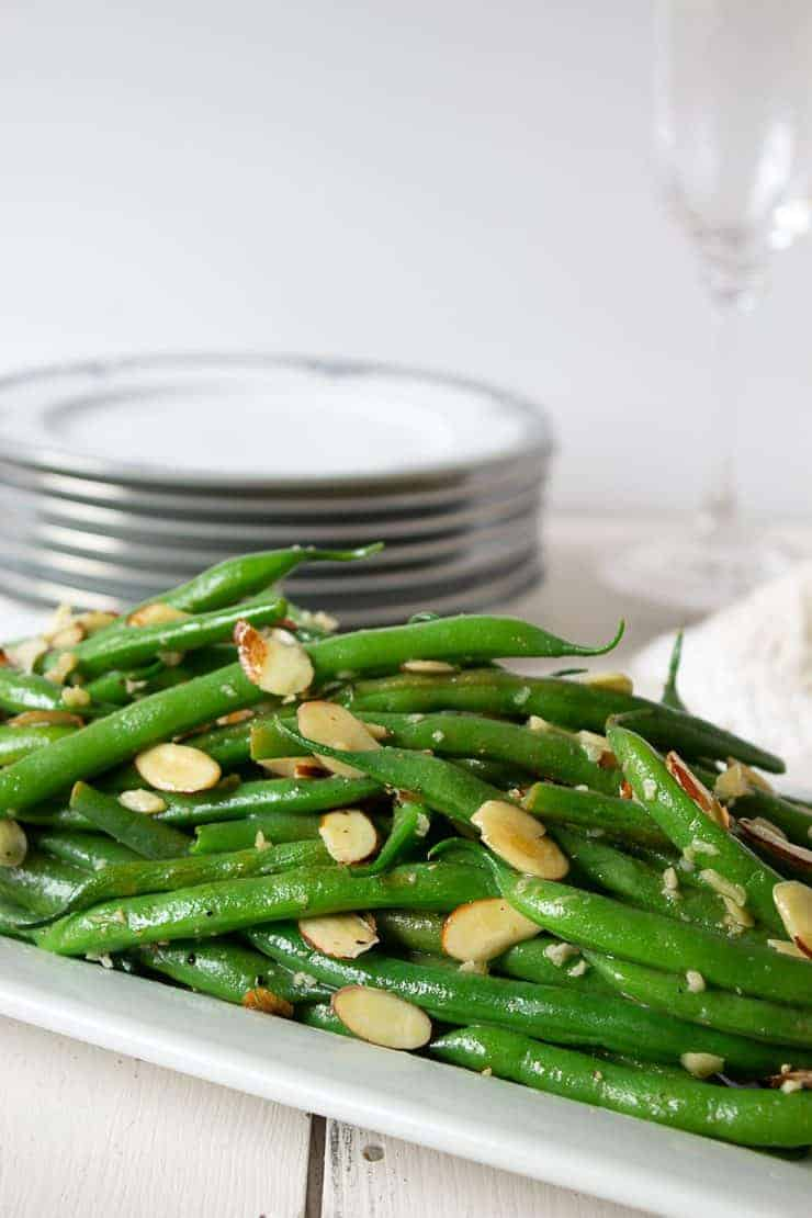 A perfect vegetable side dish for guests, a holiday dinner or a weeknight meal. Green Bean Almondine is sure to please all at your dinner table.
