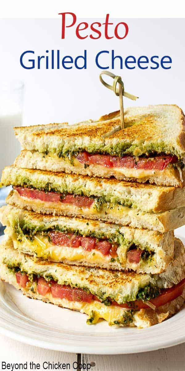 A grilled cheese sandwich with tomatoes and pesto.