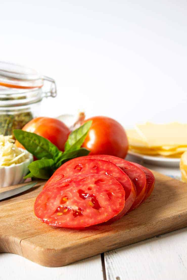 Fresh tomatoes, gouda cheese and pesto ingredients