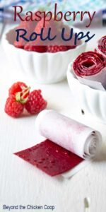 Raspberry Roll Ups wrapped in white parchment paper.