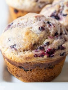Blackberry muffin with lots of blackberry bits throughout.