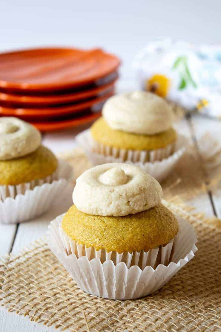 Pumpkin Spice cupcakes topped with pumpkin spice buttercream frosting.