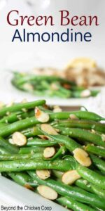 Green beans with slivered almonds on a plate.