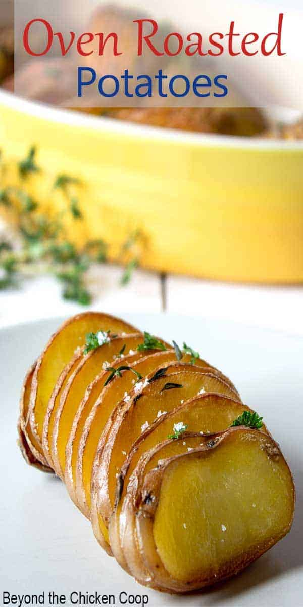 A sliced potato topped with fresh thyme.