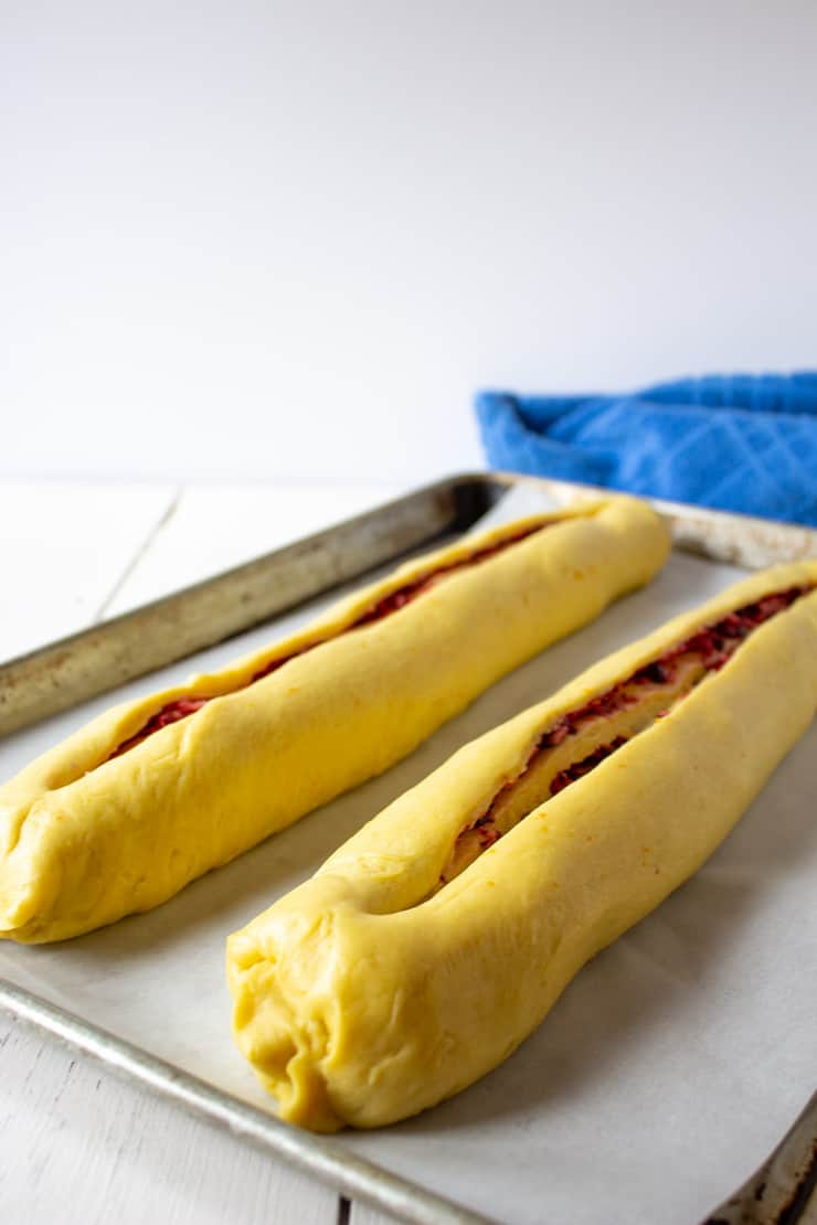 Long slits cut into the top of each roll is an important step in making Cranberry Twist Bread.