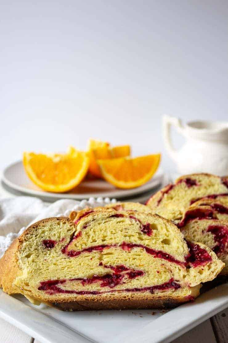 Sliced Cranberry Twist Bread on a breakfast table.