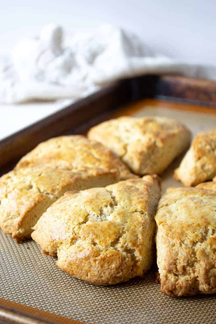 A baking sheet with golden scones.
