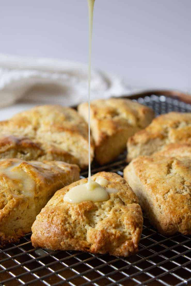 A drizzle onto a scone on a baking rack.