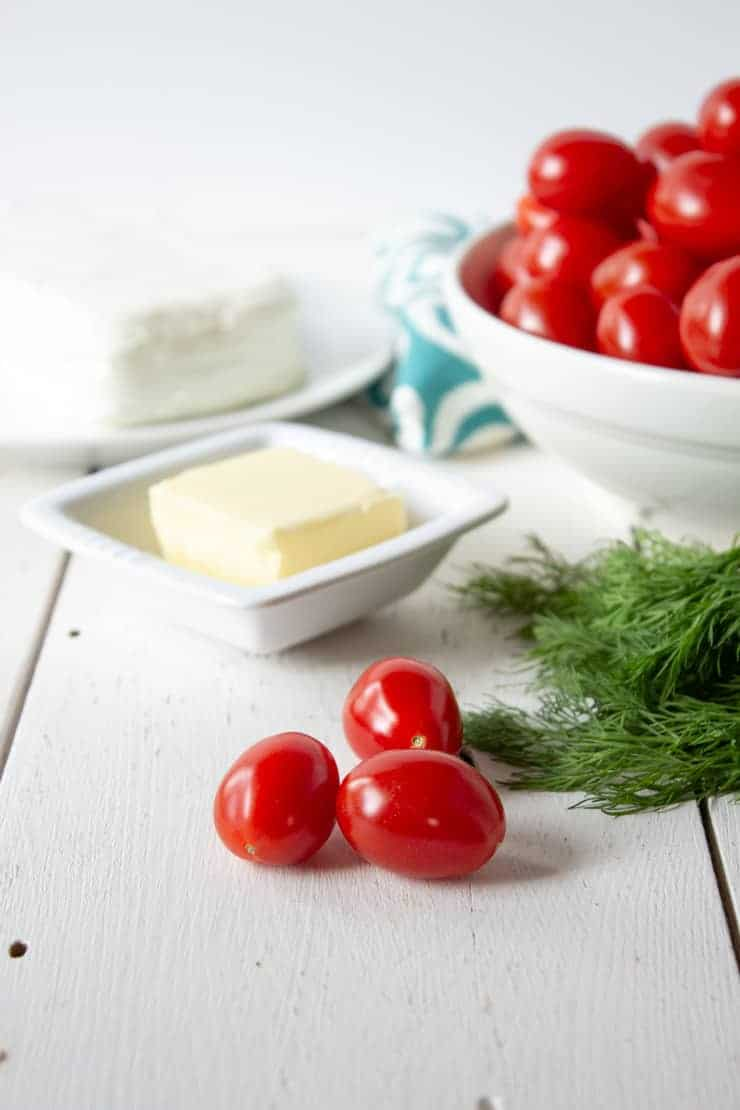 Ingredients needed for making stuffed cherry tomatoes.