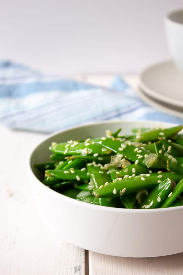 A bowlful of sauteed sugar snap peas.