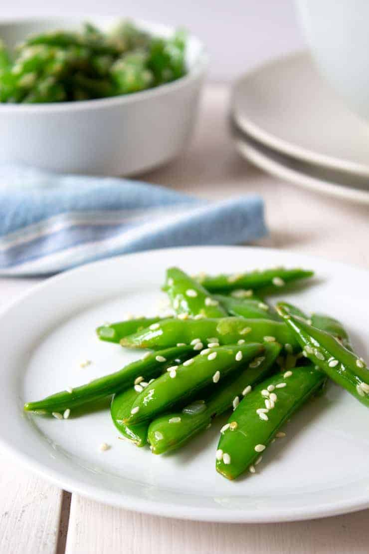 Sauteed Sugar Snap Peas on a small white plate.