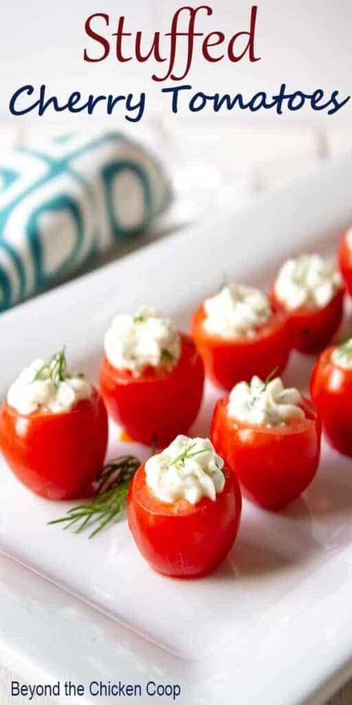 Cherry tomatoes with cream cheese and fresh dill.