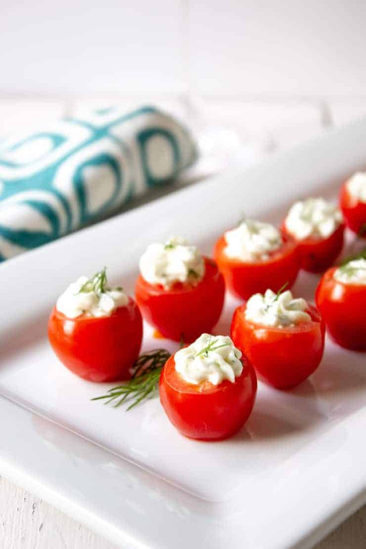 Cherry Tomatoes with a cream cheese and fresh dill filling.