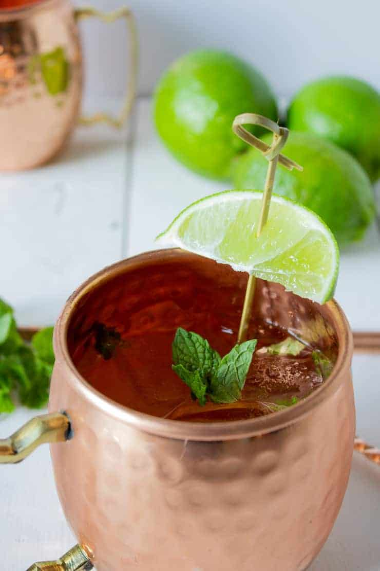 A copper mug filled with a Moscow Mule made with ginger ale