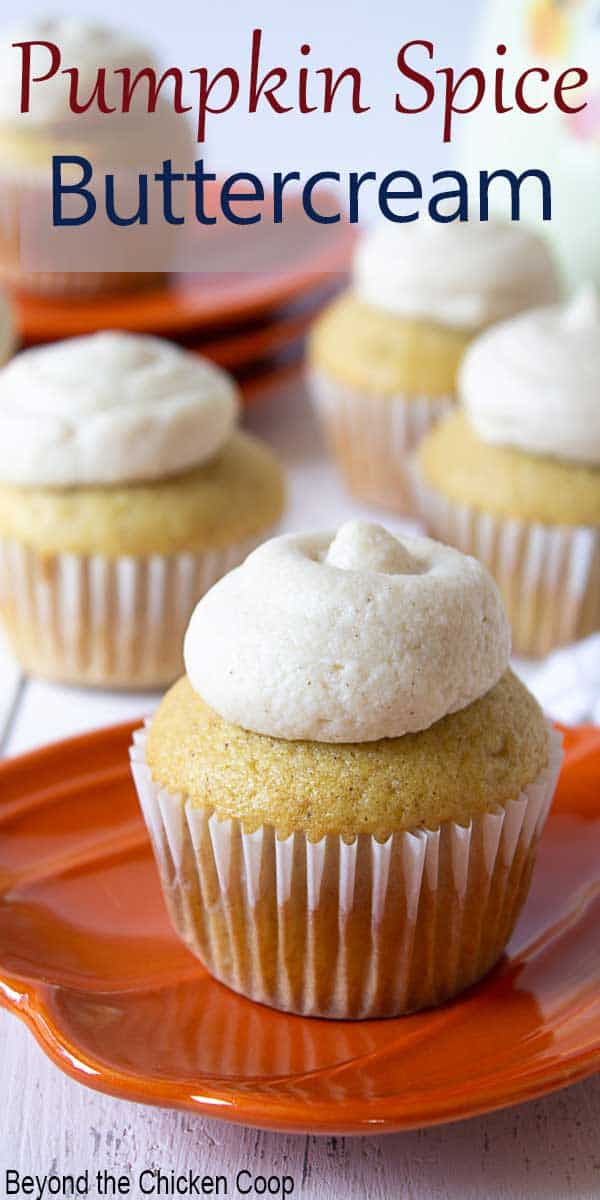 Cupcakes with frosting on orange plates.