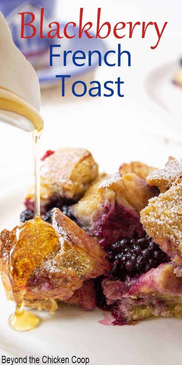 Blackberry French toast with syrup drizzling on top of the french toast.