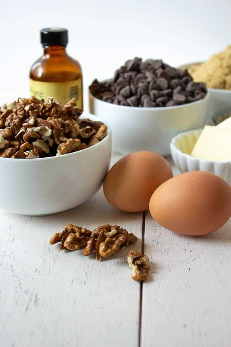 Ingredients need for making chocolate walnut tarts.