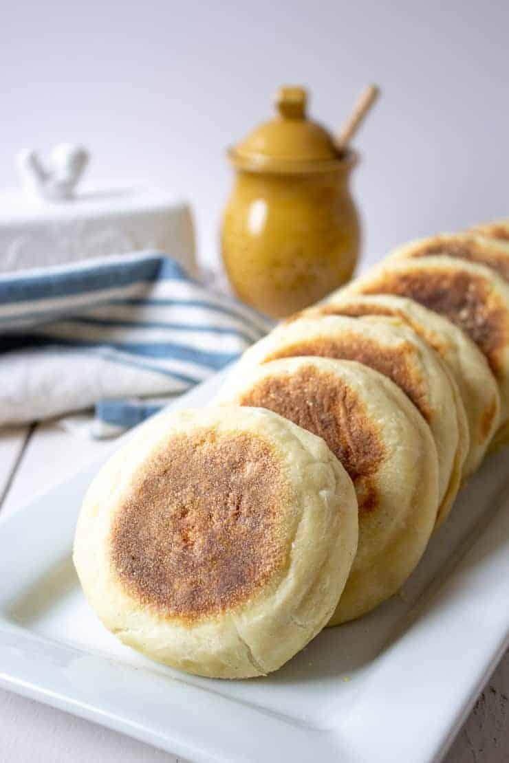A platter full of homemade sourdough English Muffins.